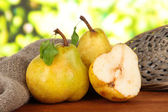 Juicy pears on table on bright background — Stock Photo