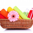 Colorful towels, cosmetics bottles and soap in basket, isolated on white — Stock Photo #28025889