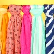 Stock Photo: Colored scarves on orange background