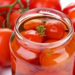 Open glass jar of tasty canned tomatoes, close up — Stock Photo