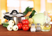 Ingredients for cooking soup on table in kitchen — Stock Photo