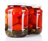 Tasty canned tomatoes in glass jars, isolated on white — Stock Photo