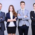 zakelijke team staande in rij op grijze achtergrond — Stockfoto