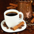 Coffe cup and metal turk on wooden table — Stok fotoğraf