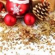 Stock Photo: Beautiful red Christmas balls, gifts and cones