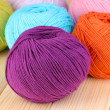 Knitting yarn on wooden background — ストック写真