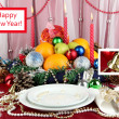 Serving Christmas table on white fabric background — Stock Photo