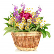 Bouquet of wild flowers in wicker basket, isolated on white — Stock Photo #28088385