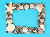 Frame of sea stones on color background — Foto de Stock
