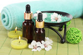 Spa composition with aroma oils on table close-up — Stock Photo