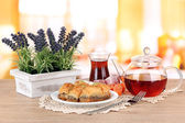 Sweet baklava on plate with tea on table in room — Stock Photo