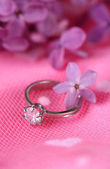 Beautiful wedding ring on pink background — Stock Photo