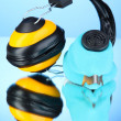 Stock Photo: Respirator and headphones on blue background