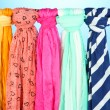 Stock Photo: Colored scarves on blue background