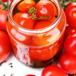 Open glass jar of tasty canned tomatoes, isolated on white — Stock Photo #28091563