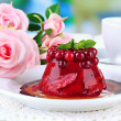 Tasty jelly dessert with fresh berries, on bright background — Stock Photo #28099767
