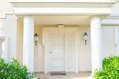 White front door of house with columns — Stock Photo