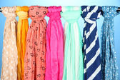 Colored scarves on blue background — Stock Photo