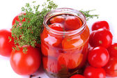 Open glass jar of tasty canned tomatoes, isolated on white — Stock Photo