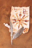 Old paper with symbols, on wooden background — Stock Photo