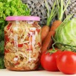 Fresh vegetables and canned on wooden table close up — Stock Photo #28101579