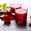 Beautiful romantic red candles with flowers, close up — Foto Stock
