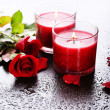 Beautiful romantic red candles with flowers, close up — ストック写真