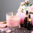Beautiful pink candle with flowers and towel on bamboo mat — Stock Photo #28104413