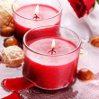 Stock Photo: Beautiful red candles with flower petals in water
