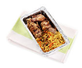 Food in box of foil on napkin isolated in white — Stock Photo