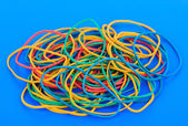 Colorful rubber bands on blue background — Stock Photo