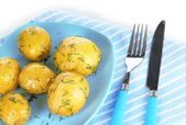 Boiled potatoes on platen on napkin isolated on white — Stock Photo