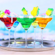 Stock Photo: Different cocktails on bright background