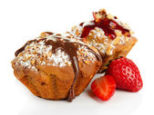 Tasty muffin cakes with strawberries and chocolate, isolated on white — Stock Photo