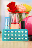 Hormonal pills in women's bedside table on room background — Stock Photo