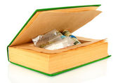 Narcotics in book-hiding place isolated on white — Stock Photo