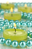 Lighted candles with beads close up — Stockfoto