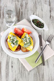 Scrambled eggs and toast on plate on napkin on wooden table — Stock Photo