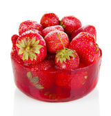 Strawberry frozen in ice isolated on white — Stock Photo