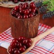 Sweet cherry in wooden basket on table close-up — Stock Photo