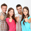 Stock Photo: Group of happy beautiful young people at room