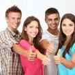 Group of happy beautiful young people at room — Stock Photo