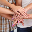 Group of young people's hands, close up — Stock Photo