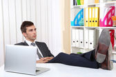 Businessman resting at his office with his shoes on table — Stock Photo