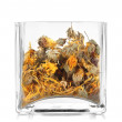 Dried herb in glass container isolated on white — Stock Photo #28293125
