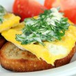Scrambled eggs and toast on plate close-up — Stock Photo