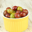 Stock Photo: Fresh gooseberries in bowl on table close-up