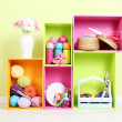 Stock Photo: colorful shelves of different colors with utensils on wall background