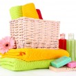Colorful towels in basket, cosmetics bottles and soap, isolated on white — Lizenzfreies Foto