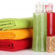 Colorful towels, cosmetics bottles and soap, isolated on white — Stock Photo